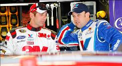 Greg Biffle, left, and Matt Kenseth talk April 23 during practice at Talladega Superspeedway. Biffle last won Sept. 21, 2008; Kenseth on Feb. 22, 2009.