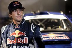 Travis Pastrana poses after breaking the world record for the longest distance jump in a rally car on Dec. 31, 2009, in Long Beach, Calif.