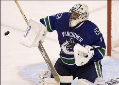 Canucks goaltender Roberto Luongo hopes to build upon his Olympic success and lead Vancouver past the Blackhawks into the Western Conference Finals.