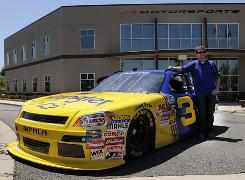 Dale Earnhardt Jr. shows off the retro No. 3 Chevy he will drive in the Nationwide Series this July at Daytona.