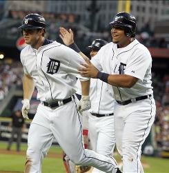 The Tigers' Brennan Boesch, left, is congratulated at home plate by Miguel Cabrera after Boesch hit a grand slam for his first career home run.