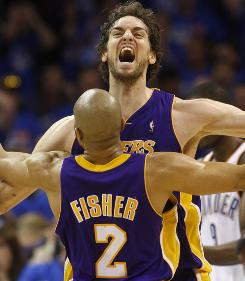 Lakers forward Pau Gasol bumps chests with Derek Fisher after tipping in Kobe Bryant's miss with a half-second left in the fourth quarter of Game 6 against the Thunder.