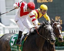 Kent Desormeaux, atop Unrivaled Belle, left, passes Calvin Borel riding Rachel Alexandra to win the $400,000 La Troienne Stakes at Churchill Downs.