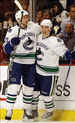 The Vancouver Canucks defeated the Chicago Blackhawks 5-1 to take a 1-0 lead in their Western Conference semifinals series.