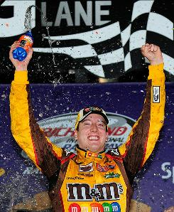 Kyle Busch celebrates in victory lane after winning the NASCAR Sprint Cup Series Crown Royal 400 at Richmond International Raceway.