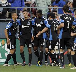 The Earthquakes' Chris Wondolowski, second from left, gets congratulated by teammates after his first-half goal against the Rapids.