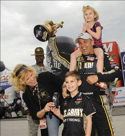 Tony Schumacher and his family celebrate his Top Fuel win at the NHRA Midwest Nationals.