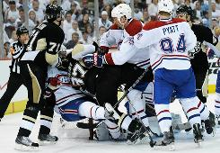 Sidney Crosby (87) of the Pittsburgh Penguins is shoved down near the net by Hal Gill (75) of the Montreal Canadiens during Game 2 of the Eastern Conference semifinals on Sunday in Pittsburgh.