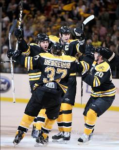 Johnny Boychuk, left, scored a goal in Game 2 as the Bruins took a 2-0 series lead against the Flyers going into Wednesday's Game 3 in Philadelphia.
