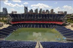 The grass at LP Field, home of the NFL's Tennessee Titans, is under water after heavy rain and flooding rivers wreaked havoc in Nashville.