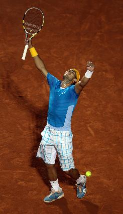 Rafael Nadal of Spain celebrates his victory at the Rome Masters on Sunday, his second clay title of the season.
