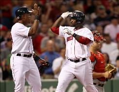 Boston's Bill Hall is greeted by teammate Adrian Beltre, left, after Hall's two-run homer in the second inning. Hall and Beltre each hit their first home runs in a Red Sox uniform in the 17-8 win.