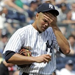 Back in the American League, the New York Yankees' Javier Vazquez is 1-3 with a 9.78 ERA.