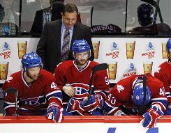 Canadiens coach Jacques Martin and players Dominic Moore, left, Tom Pyatt, center, and Maxim Lapierre lost Game 3 at home to the Penguins.