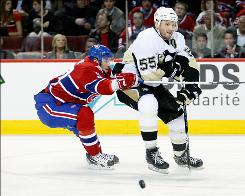 Sergei Gonchar (55), being chased by the Canadiens' Mike Cammalleri during Game 3, assisted on Evgeni Malkin's power-play goal early in the third period.