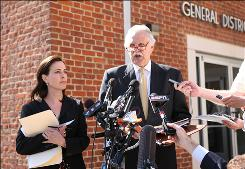 "George Huguely's defense attorney Francis Lawrence, right, called Yeardley Love's death ""an accident with a tragic outcome"" outside the Charlottesville, Va., District Court after the 22-year-old's arraignment on first-degree murder charges."