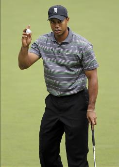 Tiger Woods say the irons put on sale on eBay weren't the Tiger Slam clubs.