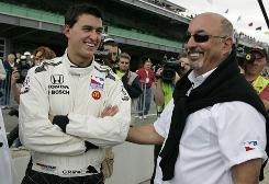 Bobby Rahal, right, talks with his son, Graham, at the Indianapolis Motor Speedway in 2008.