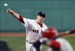 The Red Sox's John Lackey gave up two hits against his former team, getting 12 of 14 outs on ground balls during the middle innings.