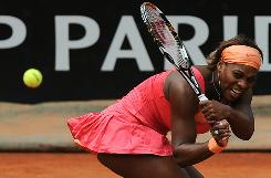 Serena Williams lashes a return during her victory Wednesday against Andrea Petkovic of Germany at the Italian Open in Rome.
