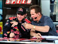 Darrell Waltrip, right, talking with driver Brian Vickers on Speed, is known for his catchphrases and an admitted outspoken nature.