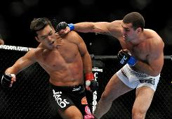 Mauricio Rua lands a blow against Lyoto Machida during their title fight in October. The close decision engendered a controversy about judging.