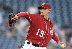Nationals starter Scott Olsen lost his bid for a no-hitter when backup catcher David Ross singled to left in the eighth inning.