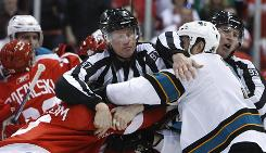 The game got chippy in the third period. San Jose's Joe Thornton, right, got a misconduct for tangling with Tomas Holmstrom.