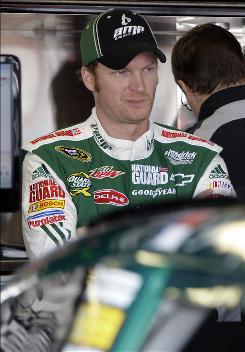 Dale Earnhardt Jr. waits by his car before a disastrous practice run for the Showtime Southern 500 at the Darlington Raceway in Darlington, S.C.