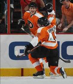 The Philadelphia Flyers defeated the Boston Bruins 5-4 in overtime to avoid being swept and extend the Eastern Conference semifinal series.