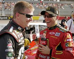 Jamie McMurray, right, is congratulated by Jeff Burton after his qualifying run for Saturday's NASCAR Sprint Cup series Showtime Southern 500 at the Darlington Raceway in Darlington, S.C.