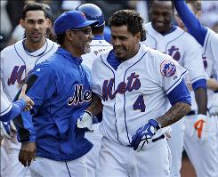 Henry Blanco, right, receiving congratulations from Mets manager Jerry Manuel, helped extend New York's home winning streak to nine games with his his game-winning walk-off home run.