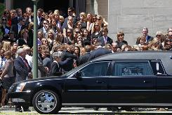 Mourners gather and embrace by the hearse at the end of the funeral for slain University of Virginia lacrosse player Yeardley Love, 22, at the Cathedral of Mary Our Queen in Baltimore, Md., on Saturday.