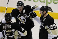 The Penguins' Sergei Gonchar, right, scored a goal and assisted on Kris Letang's tally as Pittsburgh moved a step closer to a berth in the Eastern Conference finals.