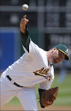 Oakland Athletics pitcher Ben Sheets hurls against the Tampa Bay Rays during the first inning of Oakland's 4-2 win.