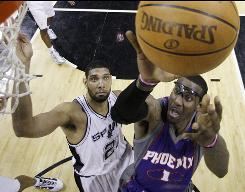 Phoenix Suns' Amare Stoudemire, right, shoots as San Antonio Spurs center Tim Duncan defends during the second quarter of Game 4 of their Western Conference semifinals.