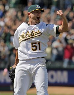 "Oakland's Dallas Braden celebrates after completing a perfect game against the Tampa Bay Rays, the A's first perfect game since Hall of Famer Jim ""Catfish"" Hunter hurled one on May 8, 1968."