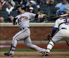 With Mets catcher Rod Barajas behind the plate, the Giants' Aaron Rowand follows through on his eighth-inning home run off Mets reliever Jenrry Meija.