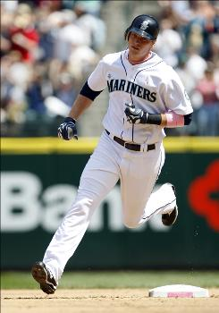 The Mariners' Michael Saunders rounds second base after hitting his first big league home run in the fourth inning.