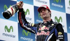 Red Bull driver Mark Webber celebrates with champagne on the podium of the Circuit de Catalunya.
