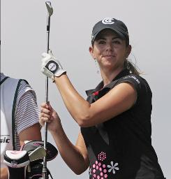 Erica Blasberg pulls a club from her bag during the Bell Micro LPGA Classic in Mobile, Ala., in 2008.
