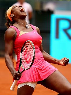Serena Williams celebrates a point against Vera Dushevina in their second-round match during the Madrid Open.