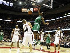 The Celtics' Tony Allen dunks over the Cavaliers' Anthony Parker in Game 5 of the Eastern Conference semifinals Tuesday night in Cleveland. Allen scored six points in the Celtics' win.