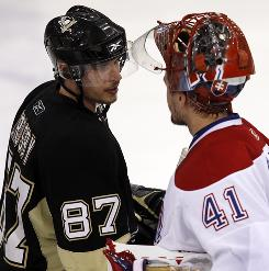 Pittsburgh Penguins star Sidney Crosby shakes hands with Montreal Canadiens goalie Jaroslav Halak after the game. Crosby was held to one goal in the second-round series.
