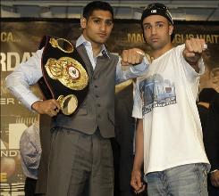Britain's Amir Khan, left, will make his American debut when he faces Brooklyn's Paul Malignaggi on Saturday at Madison Square Garden.