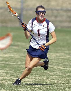 """We feel an incredible need and desire to stay together"" after the death of Yeardley Love, above, Virginia women's coach Julie Myers says."
