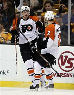 James van Riemsdyk, left, started off the Flyers' rally with a first-period tally after his team fell behind 3-0 to the Bruins.