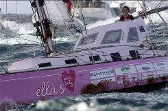 Sixteen-year-old Australian Jessica Watson sails past the finish line at the entrance to Sydney Harbour, capping off a nearly 23,000-nautical-miles voyage. Watson became the youngest person to sail solo, nonstop and unassisted around the world.