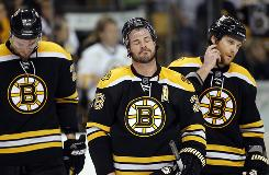 Bruins right wing Mark Recchi, center, hangs his head after falling to the Flyers on Friday.