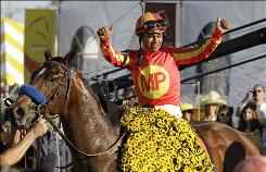 Jockey Martin Garcia celebrates aboard Lookin At Lucky after winning the 135th Preakness Stakes. Garcia was making his Preakness debut.